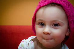 Portrait of a little girl in a knitted hat Stock Photo