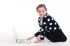 Portrait of little girl with laptop. Stock Image