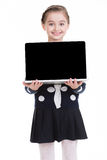 Portrait of little girl with laptop. Stock Photos
