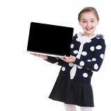 Portrait of little girl with laptop. Royalty Free Stock Photo