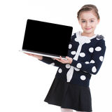 Portrait of little girl with laptop. Royalty Free Stock Photography