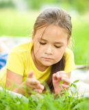 Portrait of a little girl laying on green grass Stock Photography
