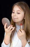 Portrait of the little girl with lipstick Stock Photo