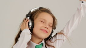 Portrait of Little Girl Listening to Music With stock video