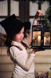 Portrait of a little girl looking at the candle in the lantern Royalty Free Stock Photos