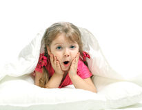 Portrait of a little girl lying in bed Stock Photography