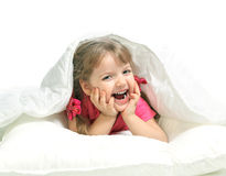 Portrait of a little girl lying in bed Royalty Free Stock Photos