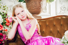 Portrait of a little girl lying on the couch Royalty Free Stock Images