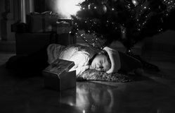 Portrait of little girl lying on floor and looking at present Stock Photos