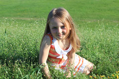 Portrait of little girl lying on the grass royalty free stock photos