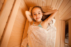 Portrait of little girl lying at sauna Royalty Free Stock Images