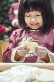 Portrait of little girl making dumplings in traditional clothing Royalty Free Stock Photography