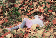 Portrait of little girl with maple leaves Royalty Free Stock Image