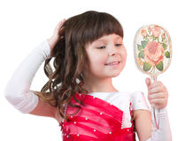 Portrait of little girl with mirror Stock Images