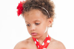 Portrait of a little girl mulatto, it is sad.  Stock Photography