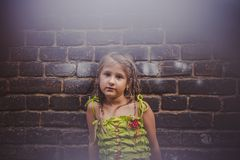 Portrait of a little girl near a brick wall Royalty Free Stock Photos