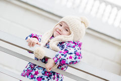 Portrait of a little girl near the fence Royalty Free Stock Photos
