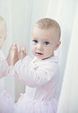Portrait of little girl  near the window Royalty Free Stock Photography