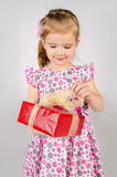 Portrait of little girl opening gift box Stock Image