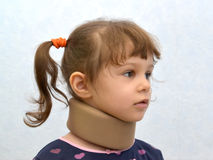 Portrait of the little girl with an orthopedic collar. Of Chance on a neck. Medicine Stock Photo