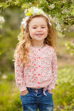 Portrait of little girl outdoors in a lush garden. Stock Images