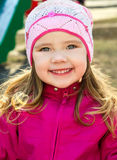 Portrait of little girl outdoors on a spring day Stock Image