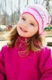 Portrait of little girl outdoors on a spring day Royalty Free Stock Photo