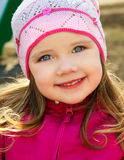Portrait of little girl outdoors on a spring day Royalty Free Stock Images