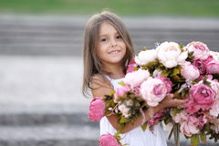 Portrait of little girl outdoors Stock Photo