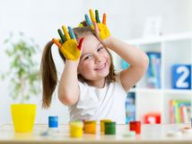 Portrait of little girl with painted palms Stock Photography