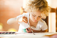Portrait of little girl painting Royalty Free Stock Photo
