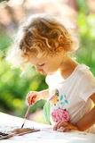 Portrait of little girl painting Stock Photography