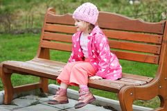Portrait Little girl in park on a bench Royalty Free Stock Image