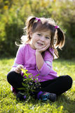 Portrait of a little girl in the park Royalty Free Stock Photo