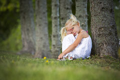 Portrait of a little girl in the park Stock Photos