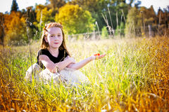 Portrait of a little girl in the park Royalty Free Stock Photos