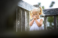 Portrait of a little girl in the park. Caucasian girl sucking thumb and in the park Royalty Free Stock Photography