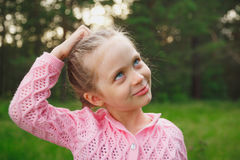 Portrait of a little girl in the park in the evening Royalty Free Stock Images