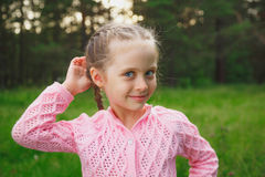 Portrait of a little girl in the park in the evening Royalty Free Stock Image