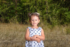 Portrait of little girl in park Stock Photo