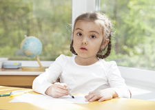 Portrait of a little girl with pencils Royalty Free Stock Photos