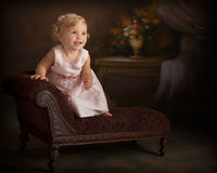 portrait of little girl in pink dress standing  Stock Images