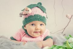 Portrait of a little girl in a pink hat. Toned image Royalty Free Stock Image
