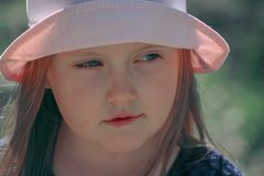 Portrait of a little girl in a pink hat stock photography