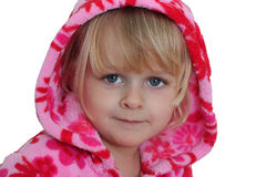 Portrait of little girl with pink hood. A horizontal of a blond 3 year old girl with blue eyes, dressed with a bright pink hoodie. Isolated on white Royalty Free Stock Image