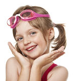 Portrait of little girl with pink swim glasses. On white background royalty free stock photos
