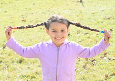 Portrait little girl with plaits Stock Images