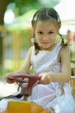 Portrait of little girl on playground Stock Photo