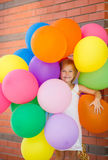 Portrait of little girl playing with air balloons Royalty Free Stock Image