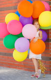 Portrait of little girl playing with air balloons Royalty Free Stock Images